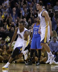 Golden State Warriors' Andre Iguodala, left, celebrates after making the game-winning score over Oklahoma City Thunder's Thabo Sefolosha (25) during the second half of an NBA basketball game Thursday, Nov. 14, 2013, in Oakland, Calif. At right is Warriors' Klay Thompson. (AP Photo/Ben Margot)