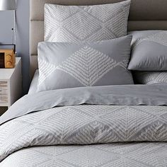 An elegant diamond pattern gives the Organic Diamond Texture Duvet a faux-textural look. The muted gray palette offers an ideal base for layering on vibrant pillows and throws. 100% organic cotton in Frost Gray.