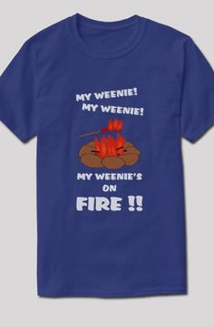 """""""My Weenie's On Fire"""" - funny camping t-shirt. Hot dog on a stick is in flames above the campfire. This weenie roast has gone horribly wrong!  Versions for light and dark shirts available in many colors and styles of t-shirts, tank tops, sweatshirts and hoodies for the whole family."""