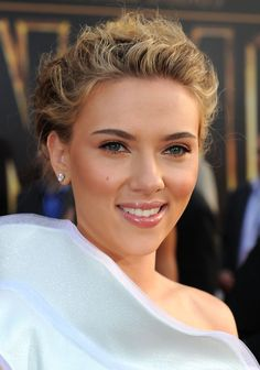 Polished beauty Scarlett Johansson ...  Swish lips...   In another collaboration with Allen, Johansson was cast opposite Hugh Jackman and Allen in the 2006 feature, Scoop.