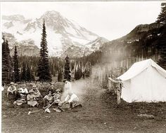 Mount Rainier National Park, Washington Shows a camping party of men and women cooking at campfire and eating near tent in Indian Henry. Aix En Provence, Mount Rainier Camping, Parc National, National Parks, Monte Rainier, Mt Rainier National Park, Camping Places, Camping Cabins, Camping Parties