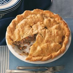 French Canadian Tourtieres Recipe -This recipe comes from my big sister. Each fall, we get together and make about 20 of these pies to use at Christmas, give as gifts or freeze for unexpected company. —Pat Menee, Carberry, Manitoba