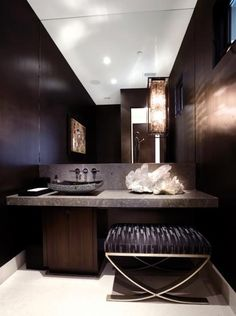 Dark and luxurious bathroom. Natural stone + wood.