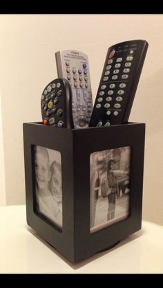 My remote holder...a rotating-photo-display pen holder.