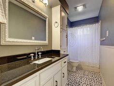 Tile floors, white cabinetry, and black granite countertops 1805 Congressional Circle, Austin TX 78746