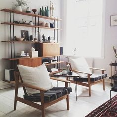 Open shelving, chairs (large pillows for backrests) simple accents, neutral tones
