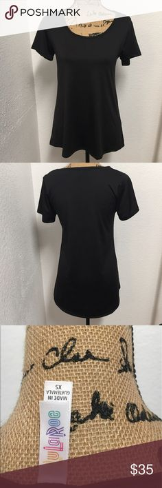 LuLaRoe Solid Black XS Classic Silky material. Only worn once! From a smoke and pet free home LuLaRoe Tops Tees - Short Sleeve