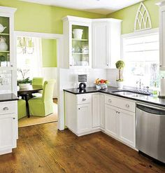 Crisp Kitchen  White Shaker-style cabinetry (combined with the white tile backsplash) keeps the look of this kitchen clean and creates the illusion of more space. Grounding the all-white look are dark granite counters, chrome hardware, and stainless steel appliances.