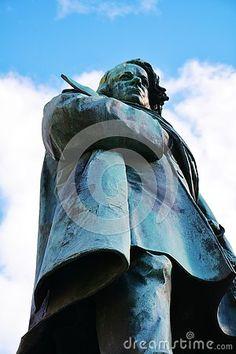 Daniele Manin bronze statue in a beautiful square against the blue sky, in Venice, Italy.
