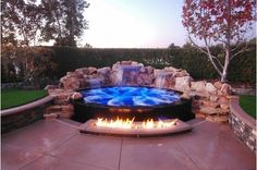 Romantic Spa with a fire pit. Visit Home and Garden Design Ideas for more!