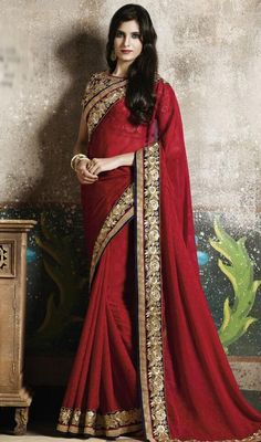 Increase your admirers with this salsa red color chiffon and jacquard sari. This wonderful sari is displaying some unbelievable embroidery done with lace and resham work. #chiffonsari #jacquardsaris #redcolorsari