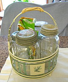 Antique mason jars with cute metal basket for sale at More Than McCoy at http://www.morethanmccoy.com
