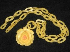 Carved celluloid rose pendant necklace with matching link chain