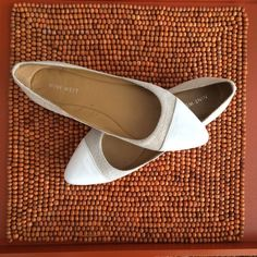 Nine West natural colored flat with white cap toe Nine West natural (textured fabric) flat with white cap toe. Comfortable and cute. Size 7 Nine West Shoes Flats & Loafers