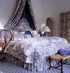 Country French look with beautiful blue and white fabrics and carpet. Gorgeous.