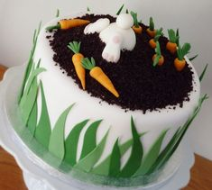 I made this funny bunny carrot cake with inspiration from many others here on Cake Central! It& -ofcourse- carrot cake inch) inside. Soil is dark chocolate cake finely grated in a blender. Cake Central, Easter Bunny Cake, Easter Treats, Bunny Cakes, Easter Cake Easy, Food Cakes, Fondant Cakes, Cupcake Cakes, Sweets