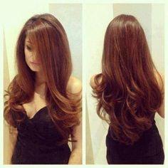 long sleek hair with a slight curl <3