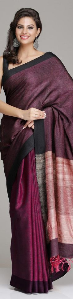 Wine colour raw silk saree with black border and pink pallu