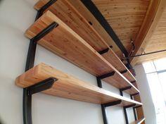 Glue-lam beam shelves and desk of FSC douglas fir. Blackened welded steel. Bullitt Foundation, Seattle.
