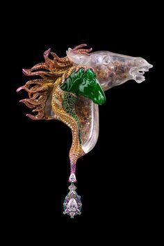 """A Love Tale"" - brooch by Wallace Chan, China, 2017.Horse-shaped Jadeite, diamond, pink diamond, jadeite, crystal, brown diamond, tsavorite garnet, yellow diamond and titanium."