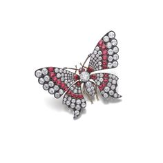 Ruby and diamond brooch, late 19th century. Designed as a butterfly with wings en tremblant, set throughout with circular-cut and cushion-shaped diamonds and oval and cushion-shaped rubies, the eyes collet-set with cabochon rubies.