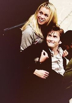 David Tennant and Billie Piper LOOK AT HIS LITTLE FACE this is literally making me cry right now. I miss them both all the way to the ends of the universe.<<<Agreed