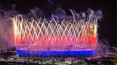 Fireworks are set off over the Olympic Stadium