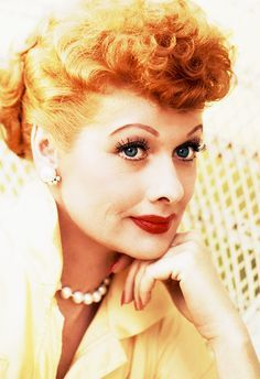 """Lucille Ball was and actress and comedian who started her career as a model and on broadway. She's best known for her role in a sitcom she wrote, """"I Love Lucy"""", which became one of the most iconic shows in television history. She later went on to start her own TV studio that produced successful shows such as """"Star Trek"""". Her signature look of bright red lips and thick, dramatic lashes has often been recreated over the years."""
