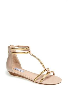 The soft pink adds a feminine touch to these sandals by Steve Madden