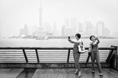 Shanghai Selfies (Women take pictures of themselves with their cell phones in front of the Shanghai skyline in this picture submitted by Jian Gao to the National Geographic Traveler Photo Contest. Shanghai Skyline, Amazing Pics, Photo Essay, Documentary Photography, National Geographic Photos, Photo Contest, Travel Photos, Documentaries, New York Skyline