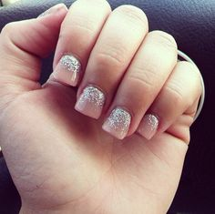 Short acrylics in a warm pink color with silver glitter!