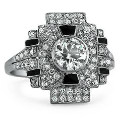 The Rubicon Ring from Brilliant Earth: This stunning art deco design dazzles with pavé set diamonds and alluring black onyx detailing. This distinctive geometric setting frames a show stopping center bezel set old European cut diamond. A truly unique design! (approx. 1.53 ct. tw.).