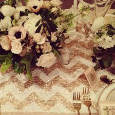 Sequined Chevron Table Runners | Simple with a bit of sparkle..think of this setup with BLACK tableware to make the center of the flowers pop. OH YEAH.