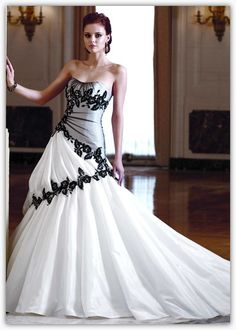 A unique gown with beautiful black detailing. I love the flow and gathering of this dress!
