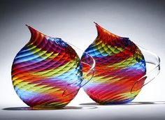 Glass pitchers by Mark Weiner  I own one of these and they are gorgeous when lit from above.