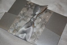 Embossed pocketfold winter wedding invitation. $8.25, via Etsy.