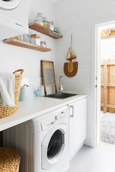 This compact, yet practical laundry in a DIY renovation of a Perth bungalow, features Ikea doors and homemade cabinetry. Photography: Angelita Bonetti | Story: homes+
