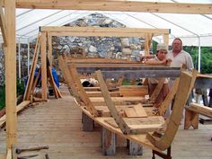 Dale Henry (r) and apprentice Brian McDonald (l) work on the bateau at Fort Ticonderoga