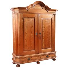North German Kiefer Pine Armoire with Hand Carved Bonnet Top, Late 1700's | From a unique collection of antique and modern wardrobes and armoires at https://www.1stdibs.com/furniture/storage-case-pieces/wardrobes-armoires/