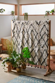 Love this room divider that uses a rug to add texture, can be swapped out to change the look and feel of the space.