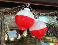 Paint white lanterns to look like fishing bobbers and hang them on a net for decoration at a fishing party