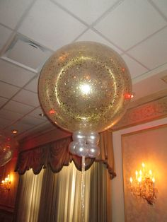 Glitter balloons!  This is a gold glitter balloon centerpiece.  Can be done in many colors for any occasion!  by www.Total-Party.com