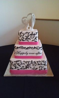 Happily ever after wedding cake with black scrollwork and a pink ribbon.