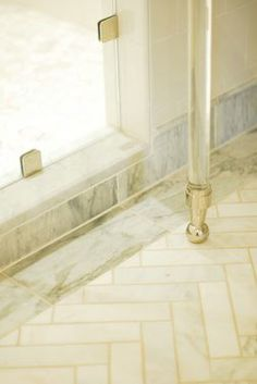 Tile detail of marble herringbone floor with border
