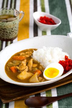 Delicious Japanese Chicken Curry recipe for a weeknight dinner! Tender pieces of chicken, carrots, and potatoes cooked in a rich savory curry sauce, this Japanese version of curry is a must-keep for your family meal. #japanesecurry #chickencurry | Easy Japanese Recipes at JustOneCookbook.com