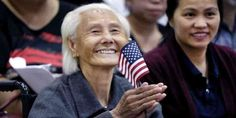 """Top News: """"CAMBODIA POLITICS: 103-Year-Old Hong Inh Cambodian Becomes US Citizen"""" - https://i1.wp.com/politicoscope.com/wp-content/uploads/2017/08/Hong-Inh-waves-an-American-flag-and-smiles-after-taking-the-oath-to-become-a-United-States-citizen.jpg?fit=1000%2C500 - Hong Inh was the oldest of more than 10,000 people who took the oath of allegiance in a cavernous room at the downtown Convention Center in Los Angeles.  """"She says she's so excited and happy,"""" said her grand"""