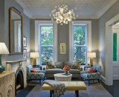 Furniture Blue Tribal Arm Chairs And Yellow Seat For Traditional Living Room Using Pop Style With Crystal Chandelier Installation Makes