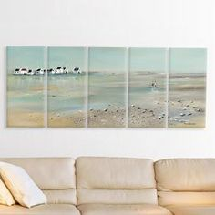 """Bring a touch of nautical flair to your entryway or foyer with this canvas print, featuring a serene shoreline scene.   Product: Set of 5 wall artConstruction Material: Engineered wood and canvasFeatures:  Ready to hangMade in the USAHand-stretched Dimensions: 50"""" H x 21"""" W x 1.5"""" D each"""