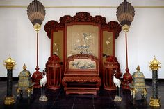 Imperial Qing Dynasty throne and furniture in the Forbidden City Palace Museum.