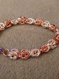 Byzantine knots made in sterling and rose gold with simple lobster clasp.
